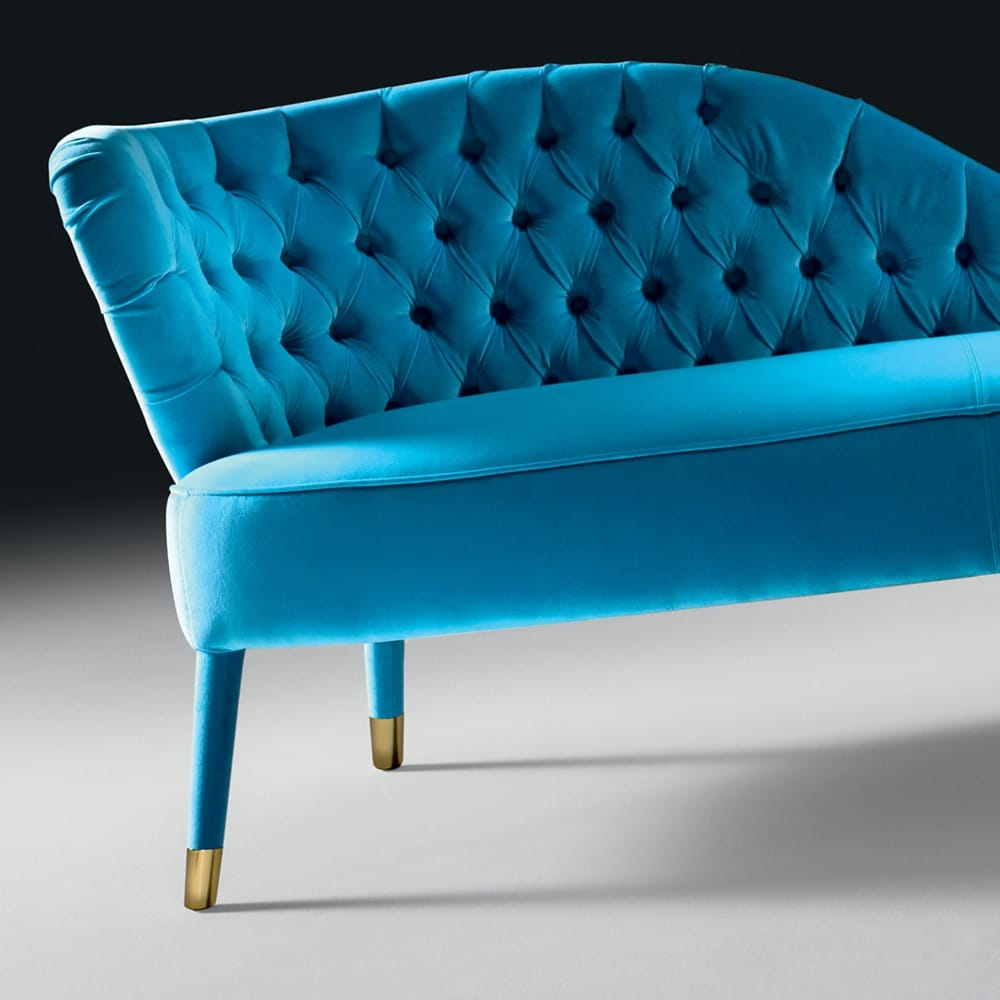 turquoise velvet button upholstered chaise longue close up