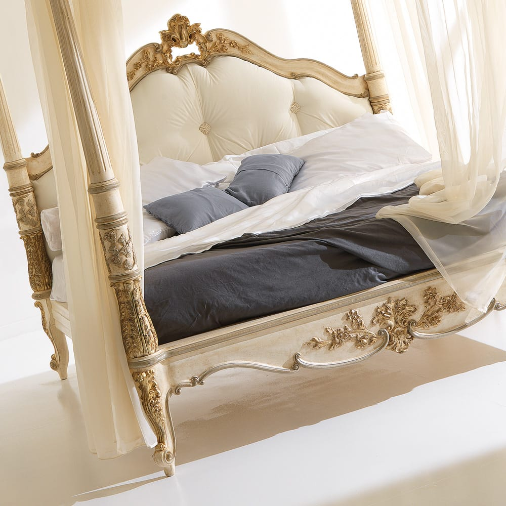 Classic four poster luxury bed cream with gold highlighted carvings