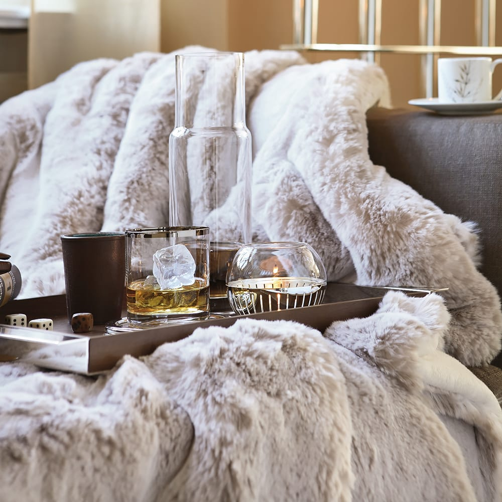Impress the guests, snow leopard faux fur throw