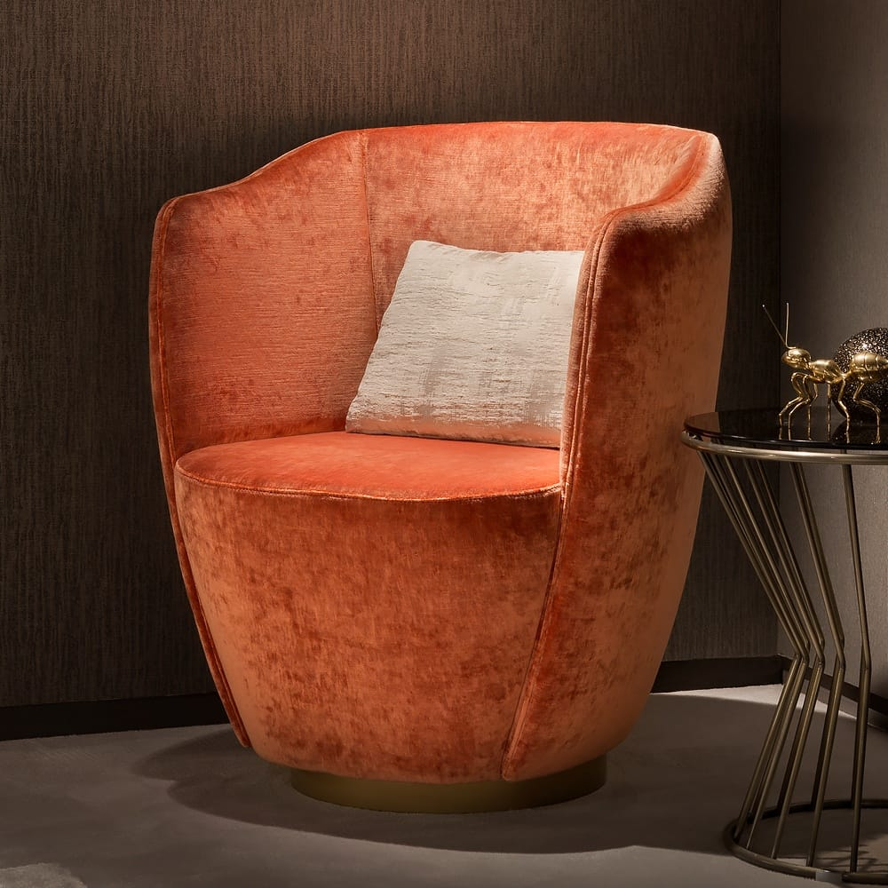 As seen in Absolutely Home magazine, contemporary orange armchair