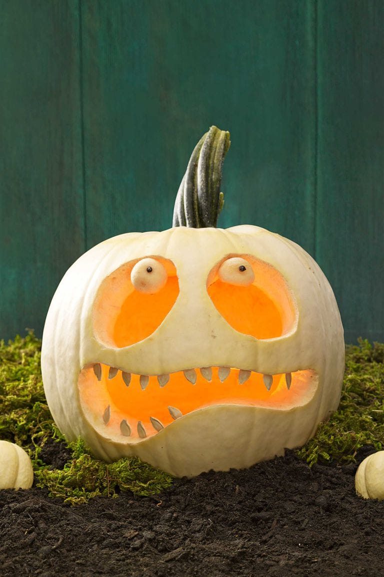 Halloween decor, carved white pumpkin with scared face