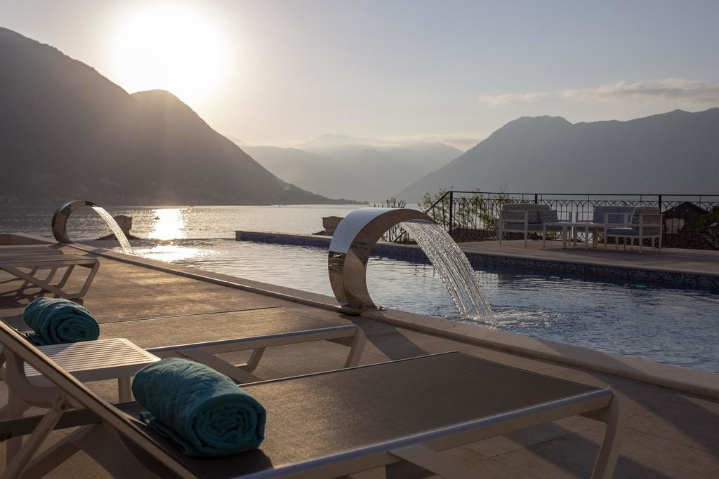 Allure Palazzi Hotel rooftop pool with view of Bay of Kotor