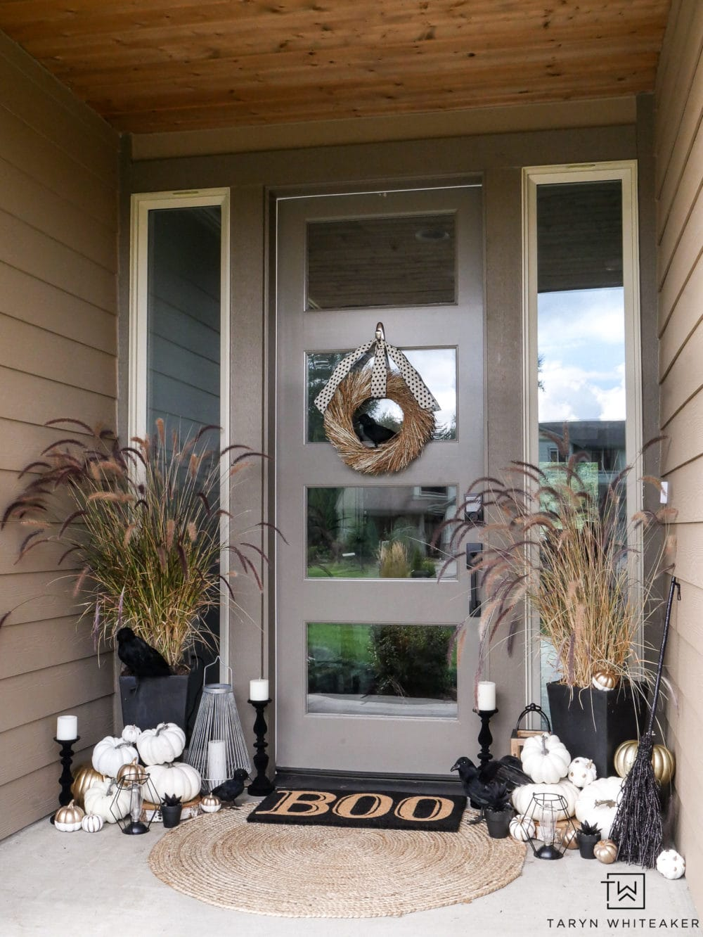 Halloween decor, porch decorated for Halloween in black, white and gold