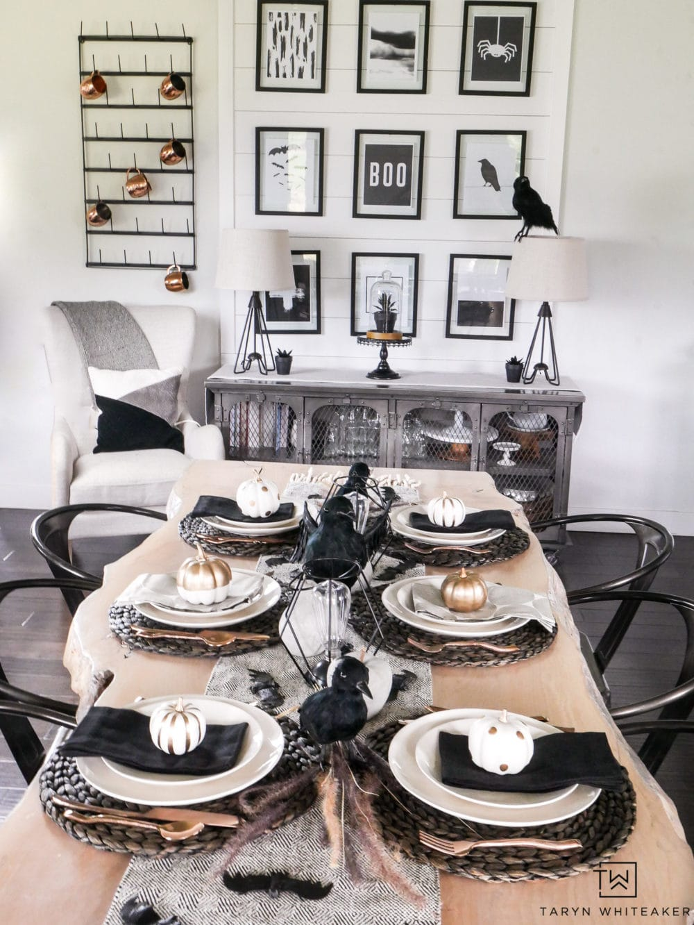 Halloween Home, table decorated in black and white with pumpkins, crows, black accessories