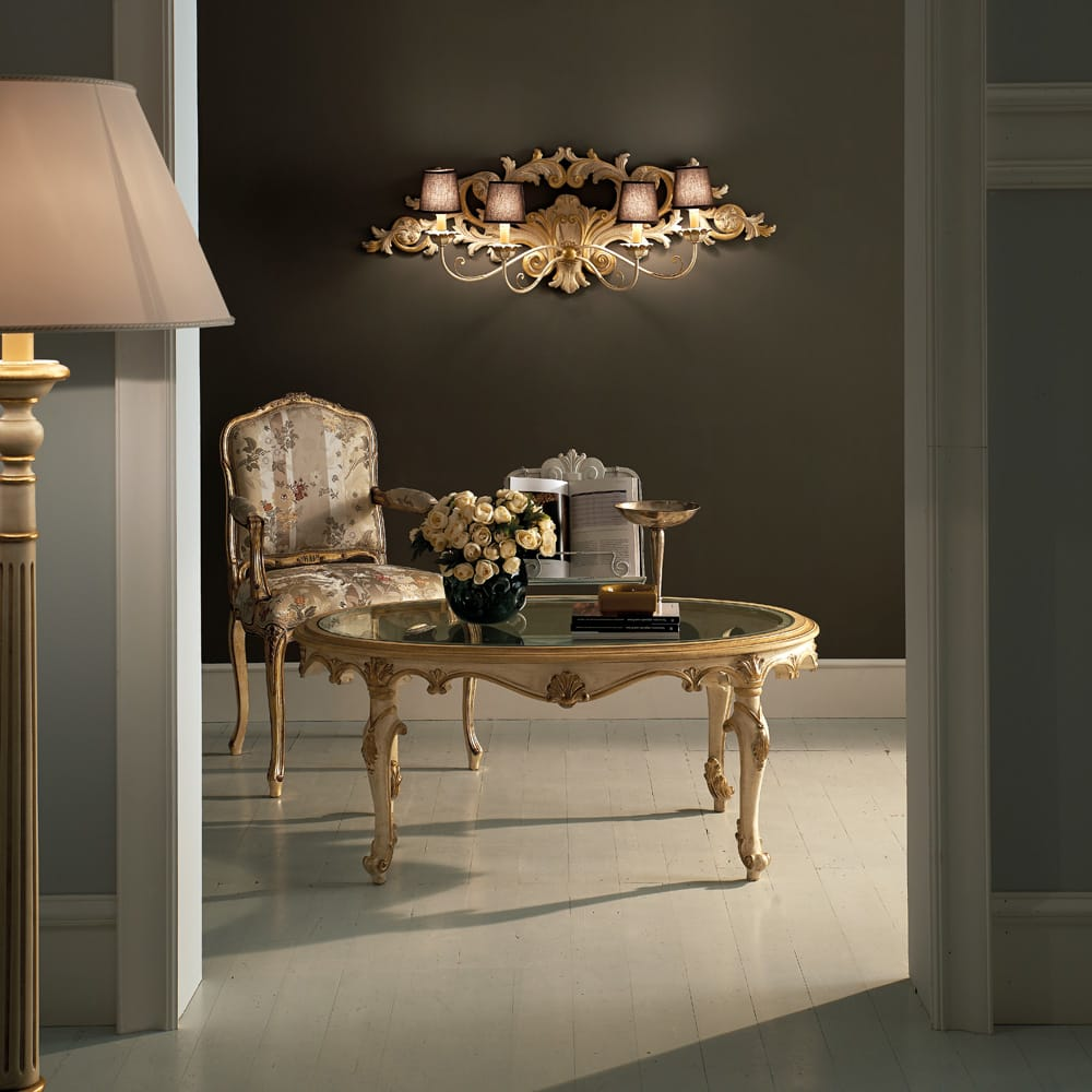 Florence Collection luxury furniture, coffee table and chair underneath ornate wall light