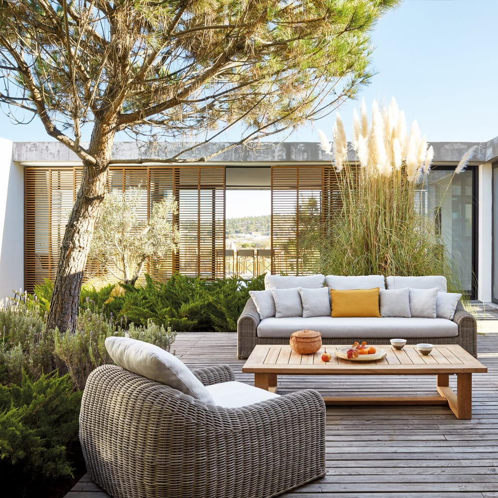 outdoor furniture, luxury wicker sofa and chair on decking