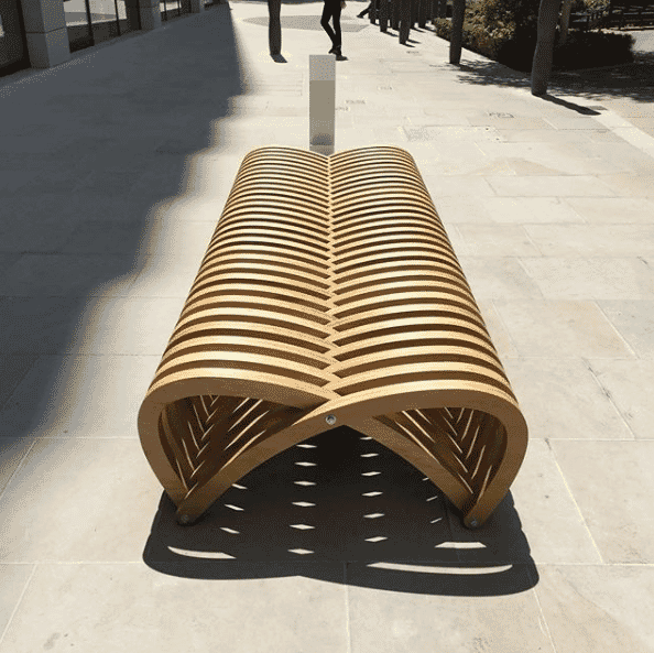 Double Bench curved wood bench by Mills Turner Architects