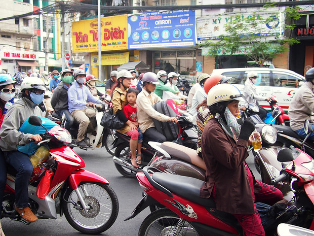 Vietnam, Saigon, Ho Chi Minh City, moto taxis in very busy traffic