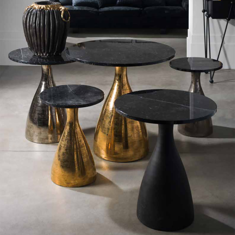 black marble side table aged metallic base meet the designers