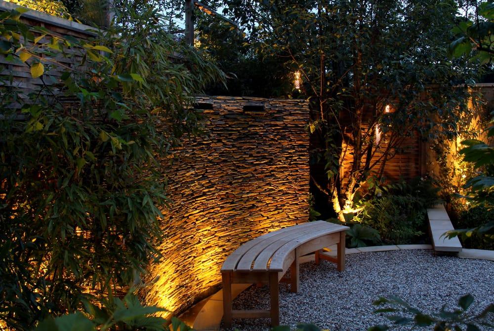 uplighters in courtyard garden trends 2018