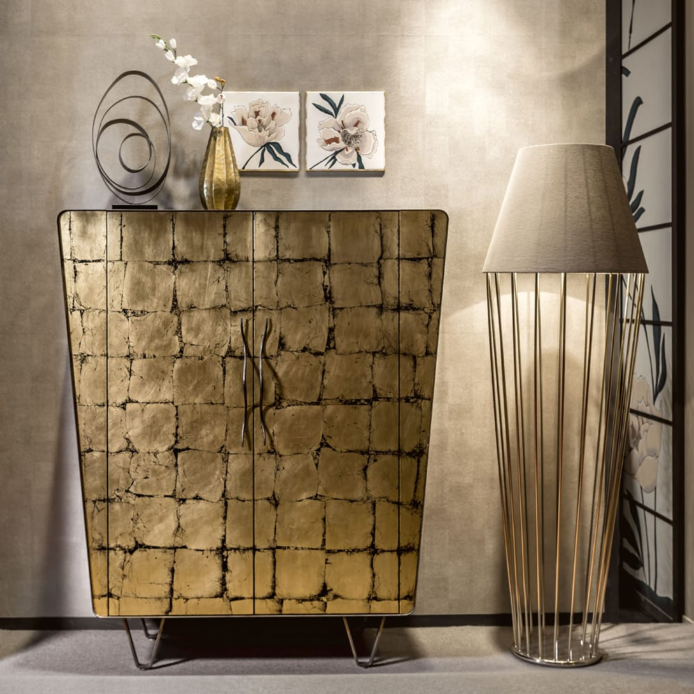 Impress the guests, modern cabinet with antiqued gold square decoration, black modern feet, trapezoid shape