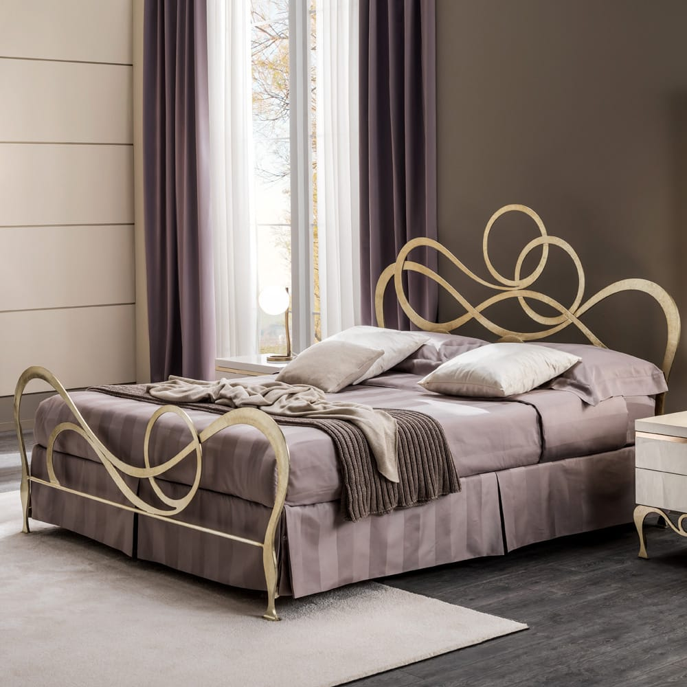 Chelsea Collection, ornate bed with swirly headboard and footboard, champagne leaf finish