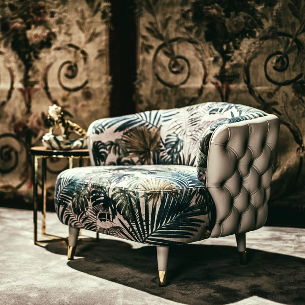 Impress the guests, tub chair with cream leather, deep buttoned back and bold floral fabric cushions