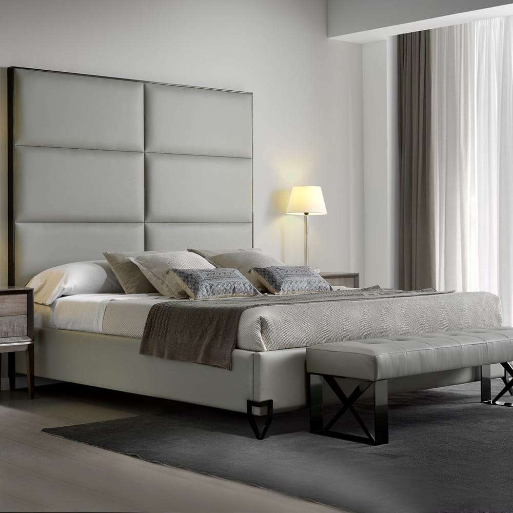 Contemporary bed, upholstered in ivory leather with tall, 6-panelled leather headboard, autumn arrivals