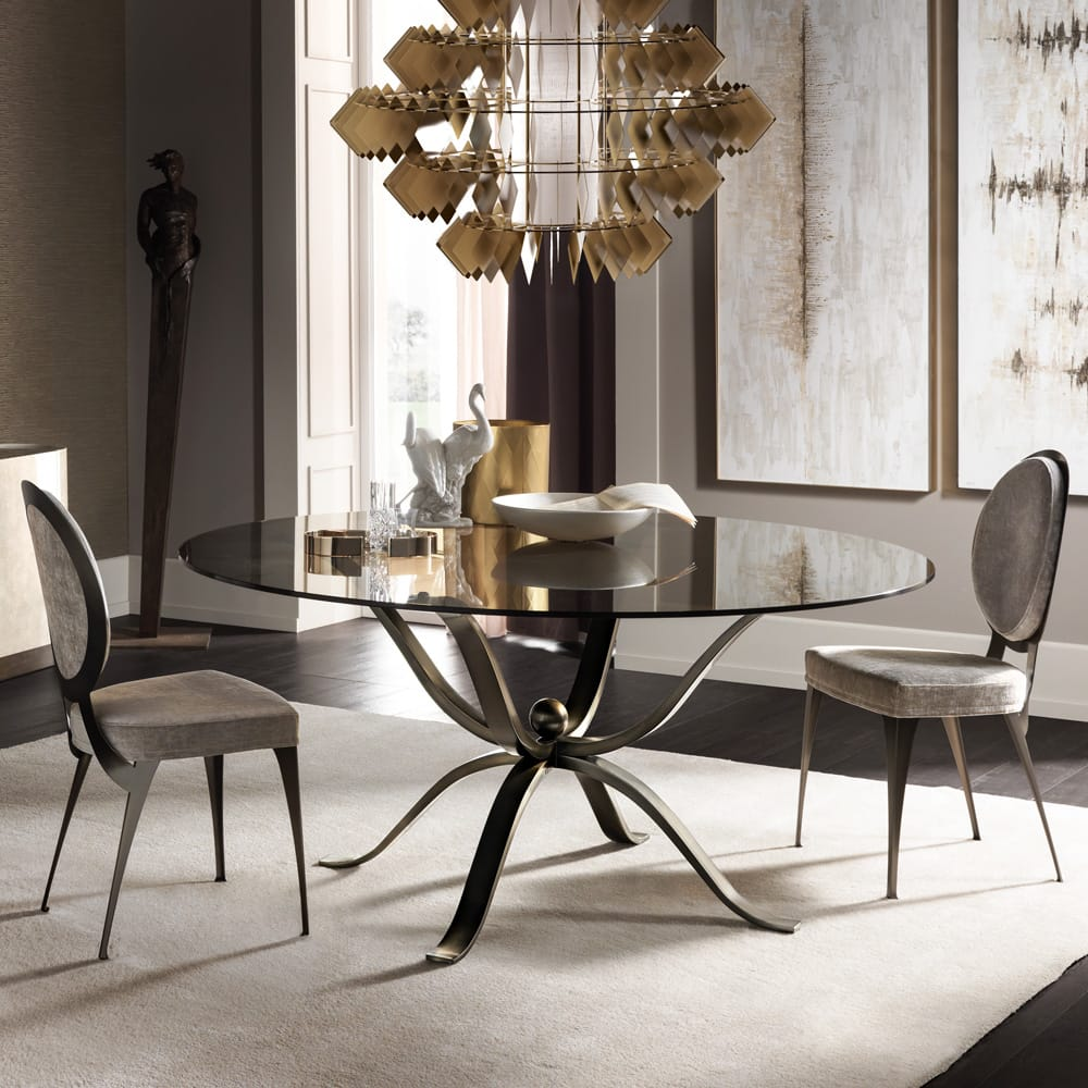 Impress the guests, round smoked glass dining table with brushed bronze legs