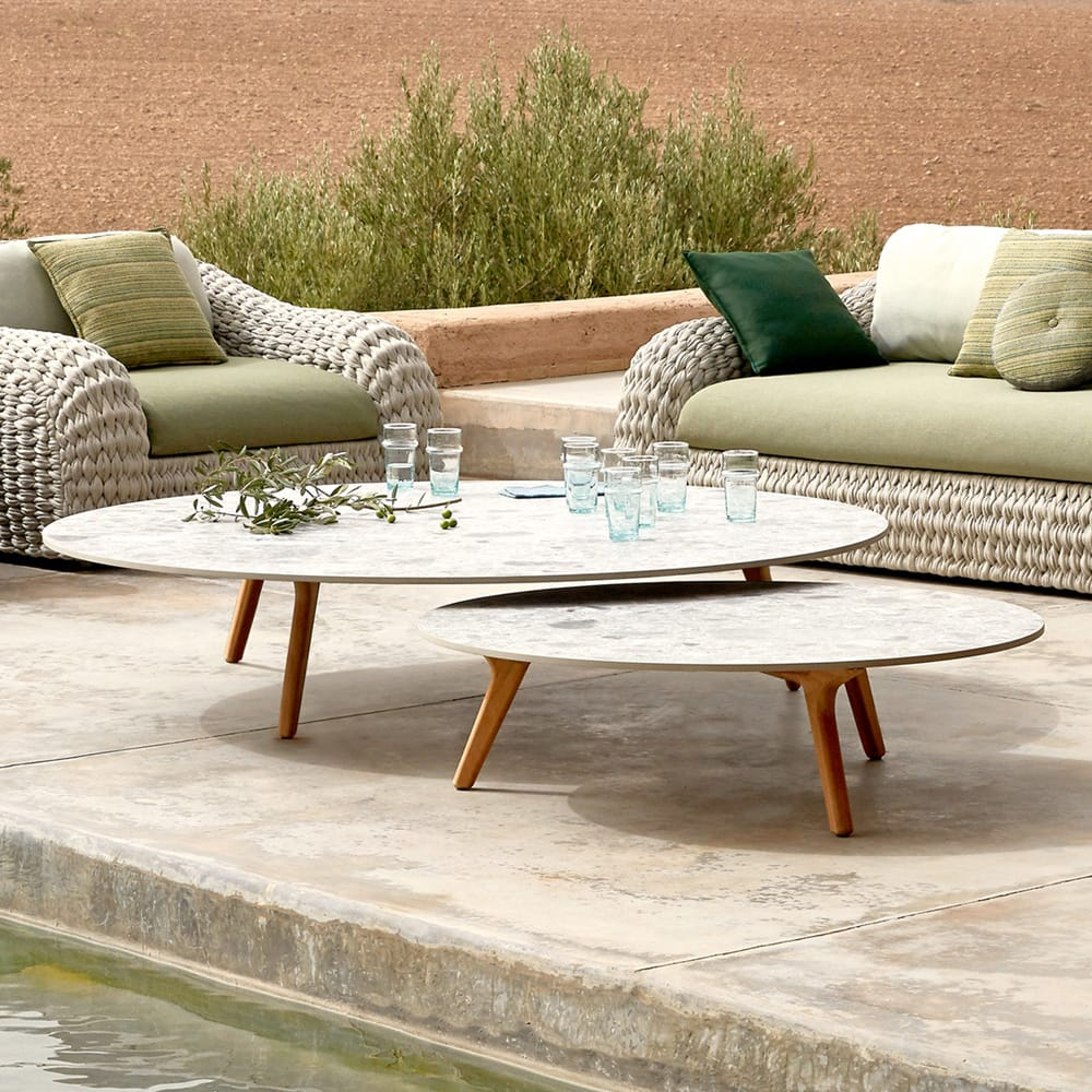 outdoor furniture, two circular contemporary coffee tables, white faux marble top