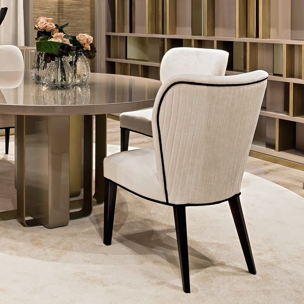 Impress the guests, textured velvet dining chair in cream with black piping and black legs