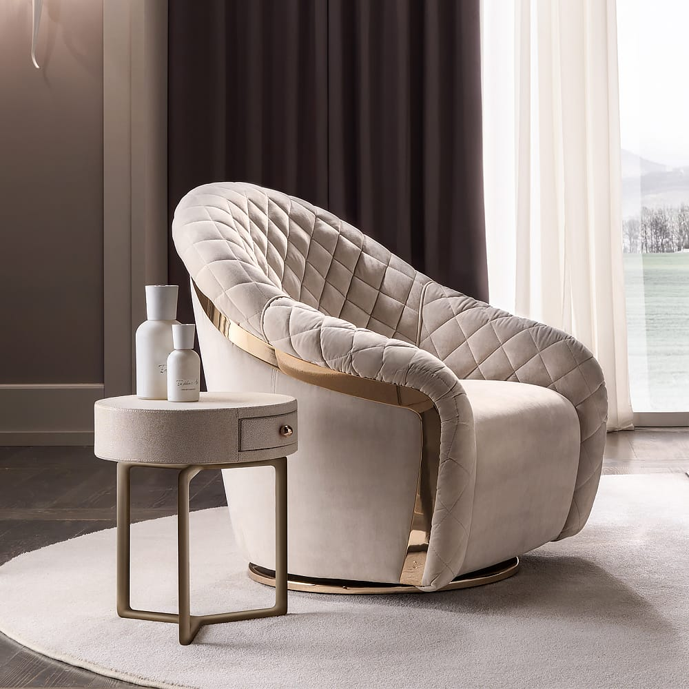 statement furniture, comfortable swivel armchair in quilted leather