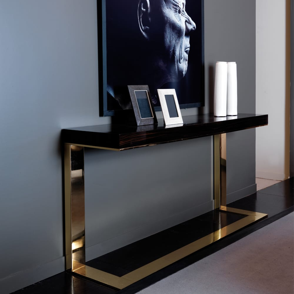 statement furniture, sleek contemporary console table, dark macassar top, gold one-piece legs and base