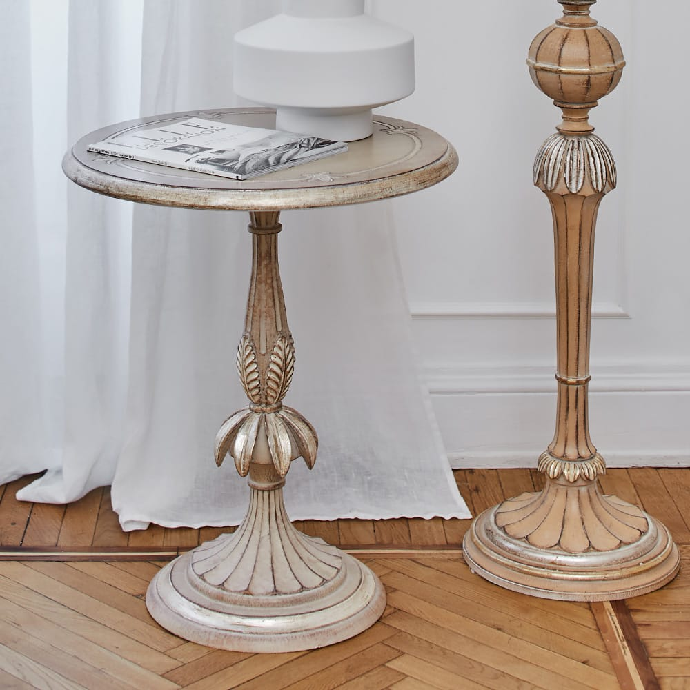 Impress the guests, ornate, carved side table with leaf design and pale gold finish