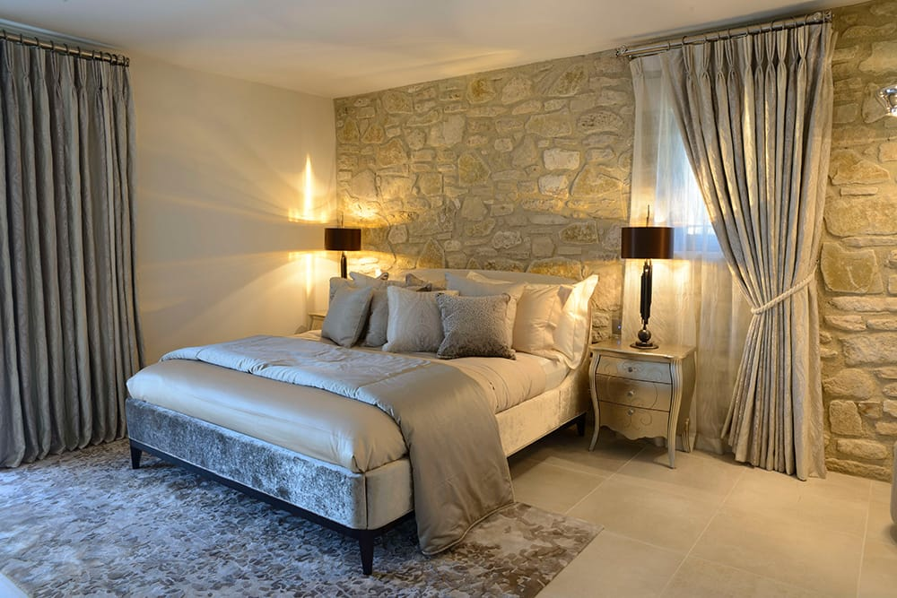 5 Star Interior Design, Award winning Provence villa, guest bedroom with honey stone wall, luxury furnishings