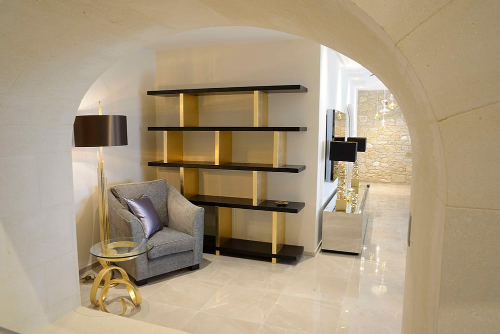 5 Star Interior Design Award winning Provence villa, quiet library corner with bookshelves, lilac armchair, lamp and bespoke side table
