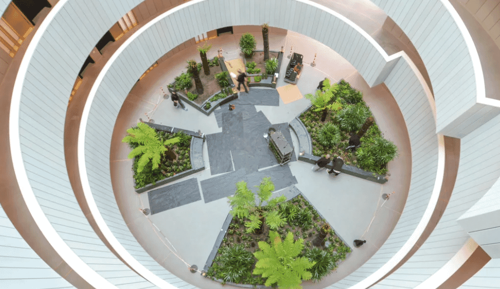 Gasholders atrium with planting in centre of residential drum RIBA Awards 2018