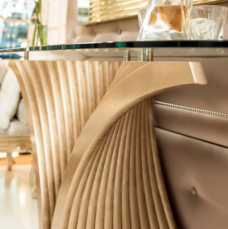 British Design, console table close up, fan shaped base in champagne leaf, glass top