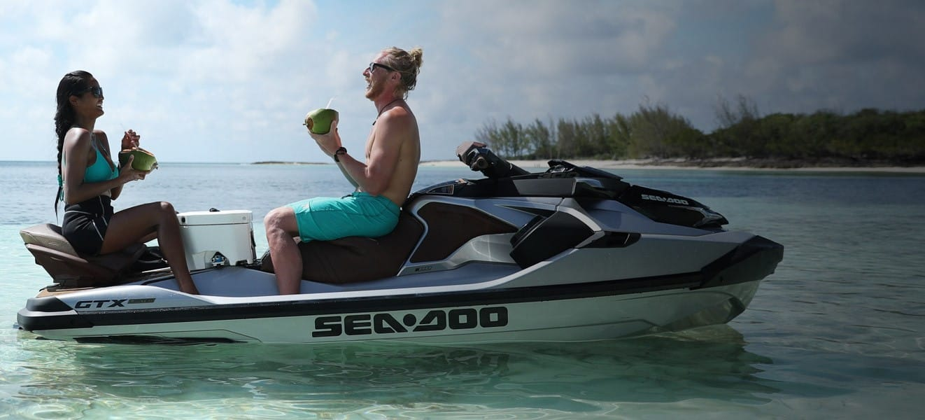 Yacht toys, 2 people having a picnic on the back of a Sea-doo