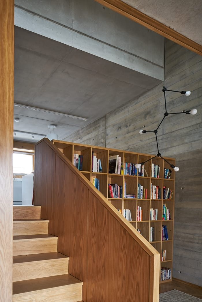 Weston Street Interior with wooden stairs, bookcase, patterned concrete walls, RIBA Awards 2018