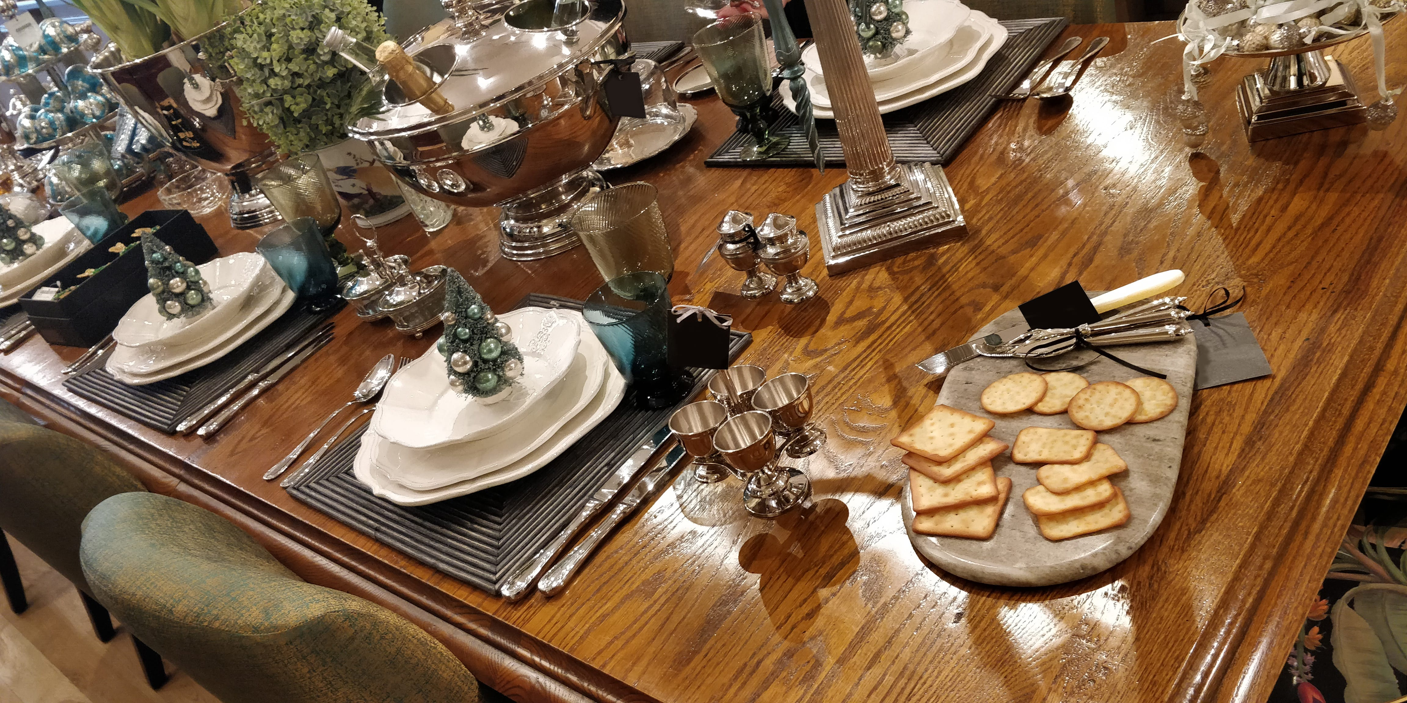 Christmas all wrapped up, elegant Christmas table setting, cheese board, decorations