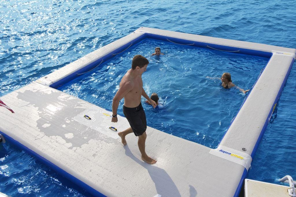 Yacht toys, inflatable sea pool, 2 people in the water, 1 person walking around the edge