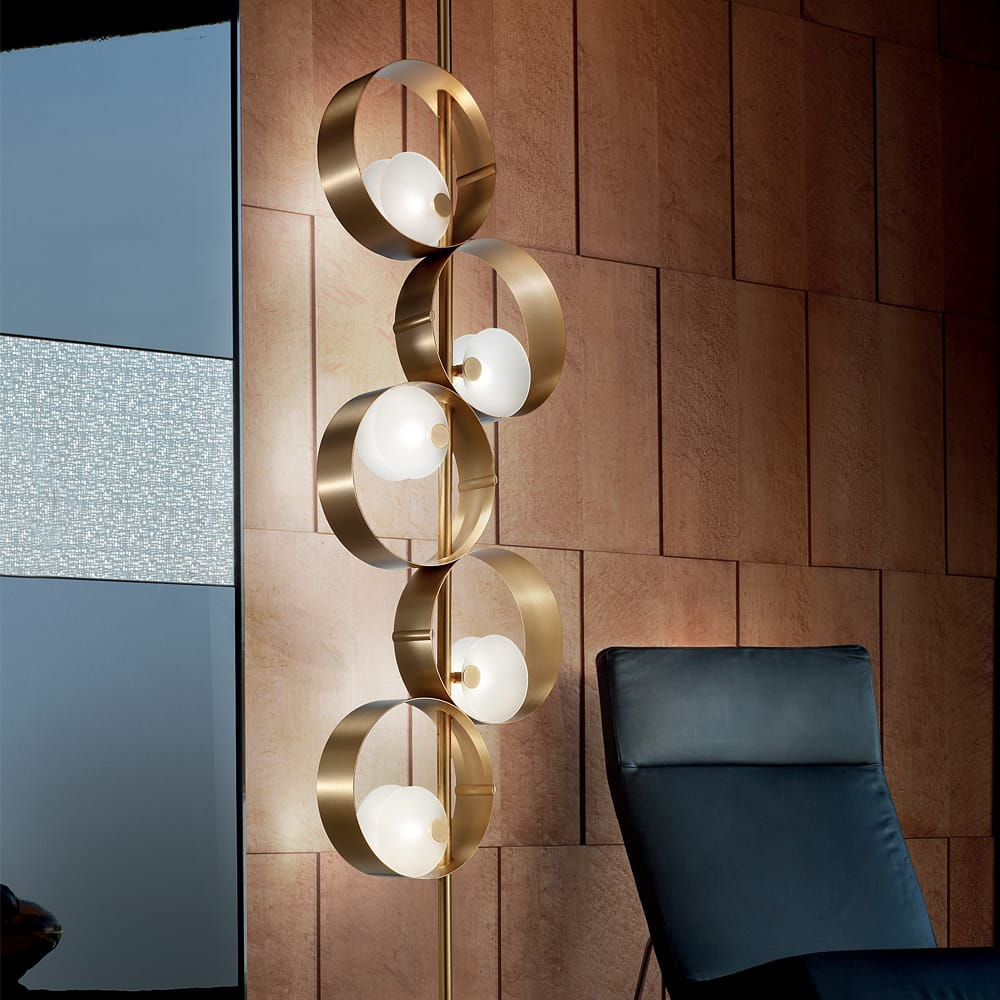 impress the guests, floor to ceiling light, 5 gold circles suspended in line, each with off-centre light within