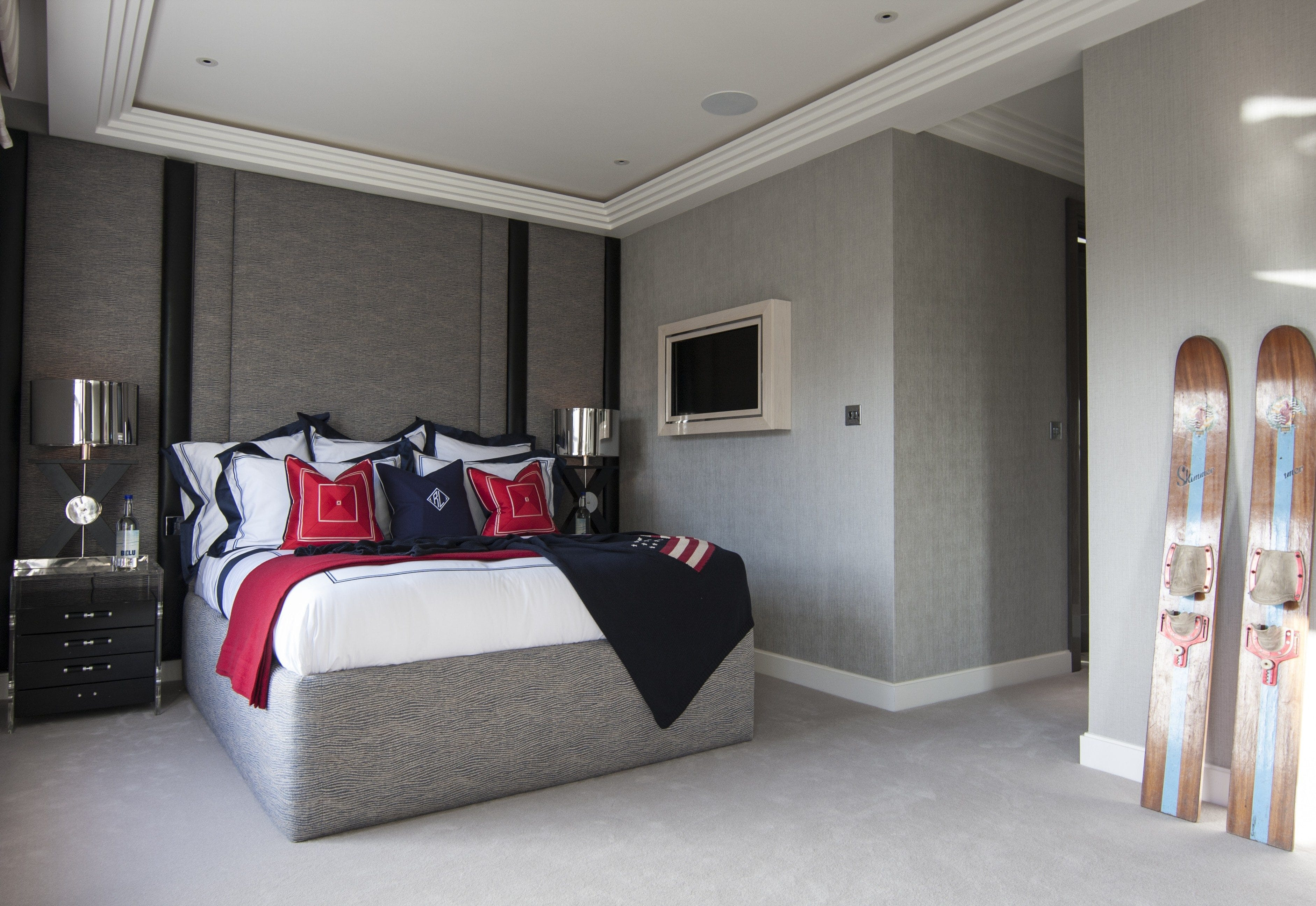 bespoke furniture bed wallcoverings soft grey red blue accents