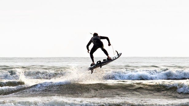 Yacht toys, person on a motorised surf board, small waves