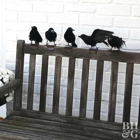 Halloween decor, outdoor bench with crows perched on the back