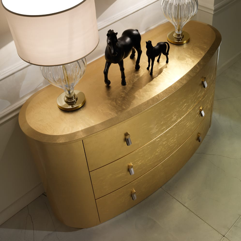 set-the-atmosphere-gold-oval-chest-of-drawers