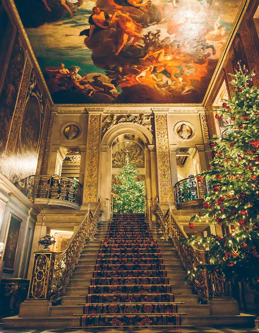 Magical Christmas Places, Chatsworth House interior staircase with Christmas trees