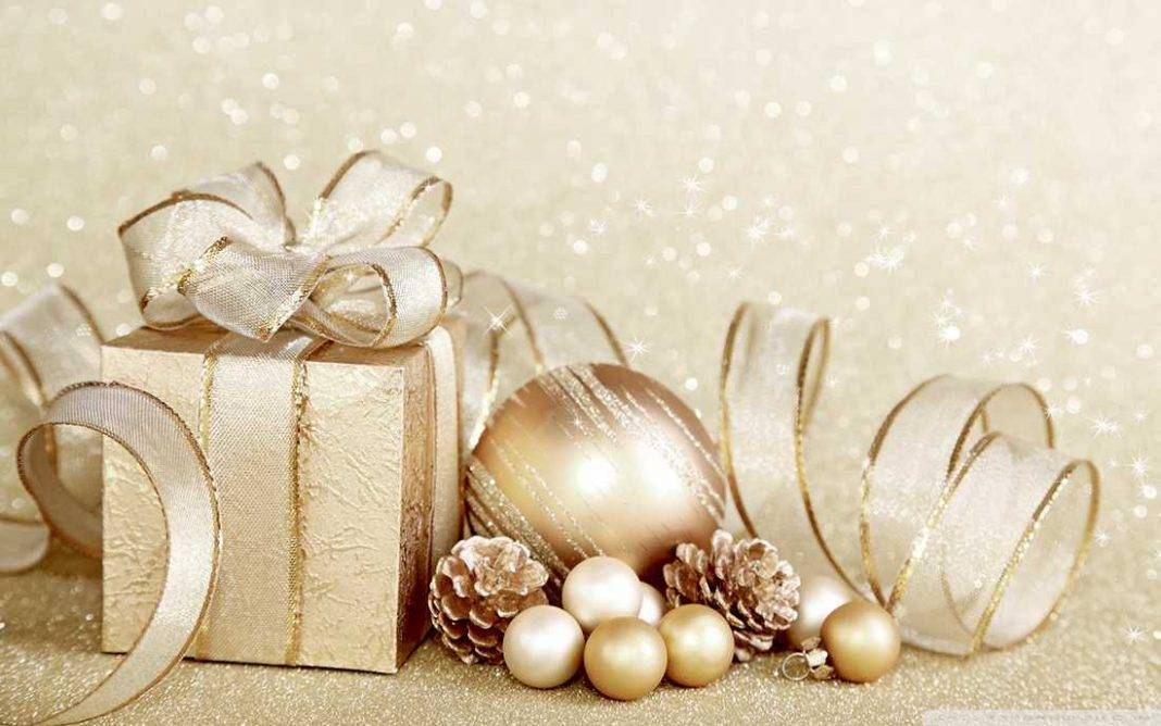 Last minute gifts, gold present with ribbon and baubles