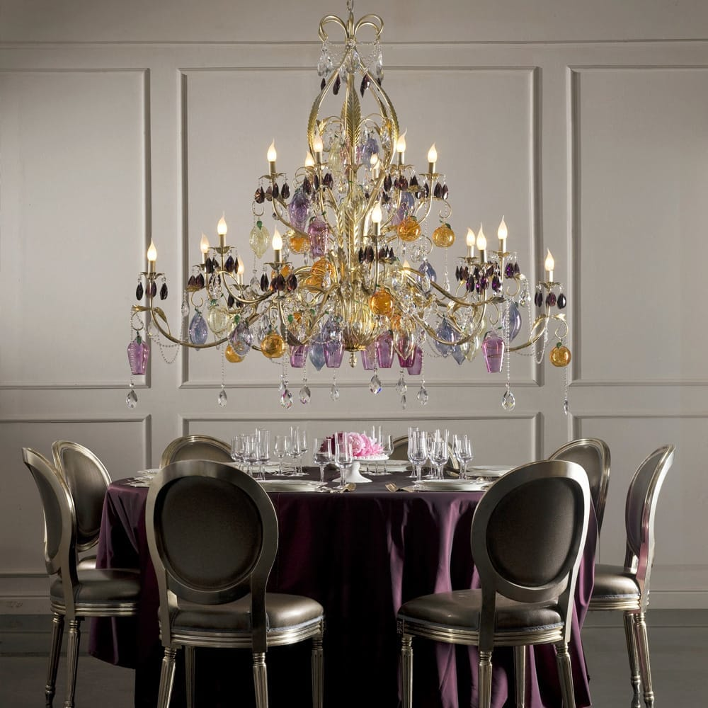 Top 10 interiors blog posts, large chandelier with leaves and coloured crystal drops, over dining table