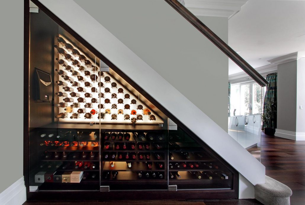 under stairs wine cellar with glass doors
