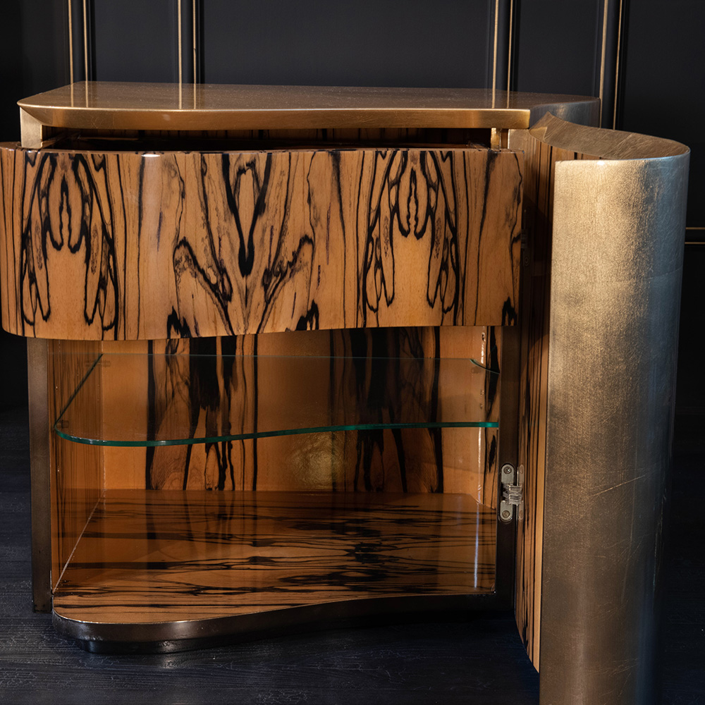 ebony wood and glass interior of small cupboard, with gold leaf finish