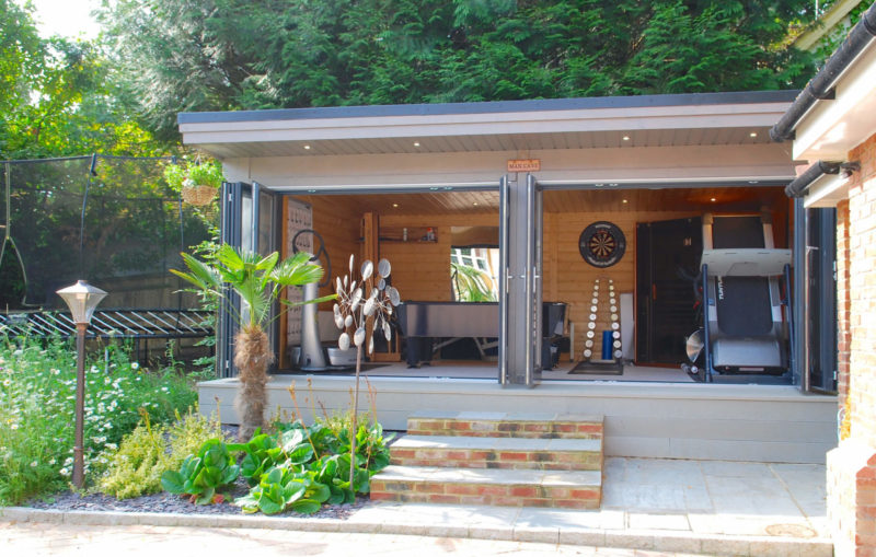 design trends, modern wooden garden room used as a games room and gym