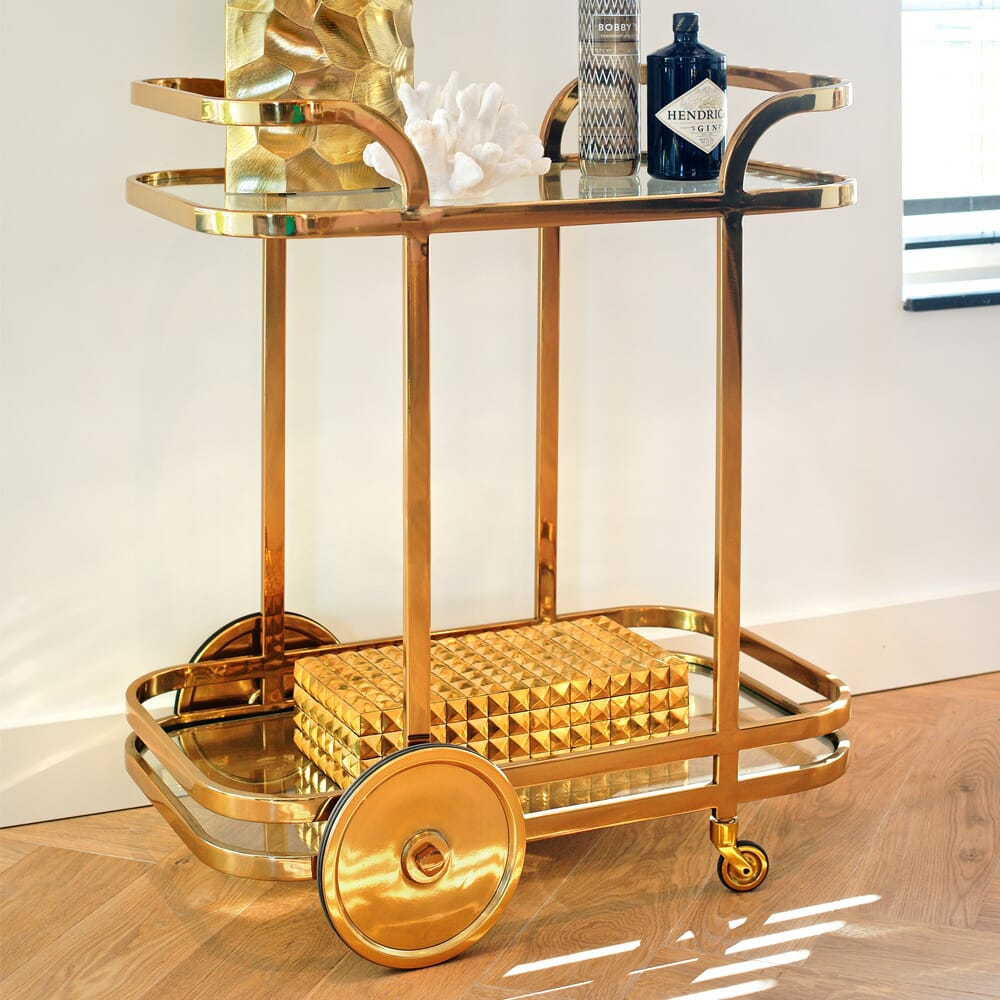 interior design trends, drinks trolley in gold finish, art deco inspired
