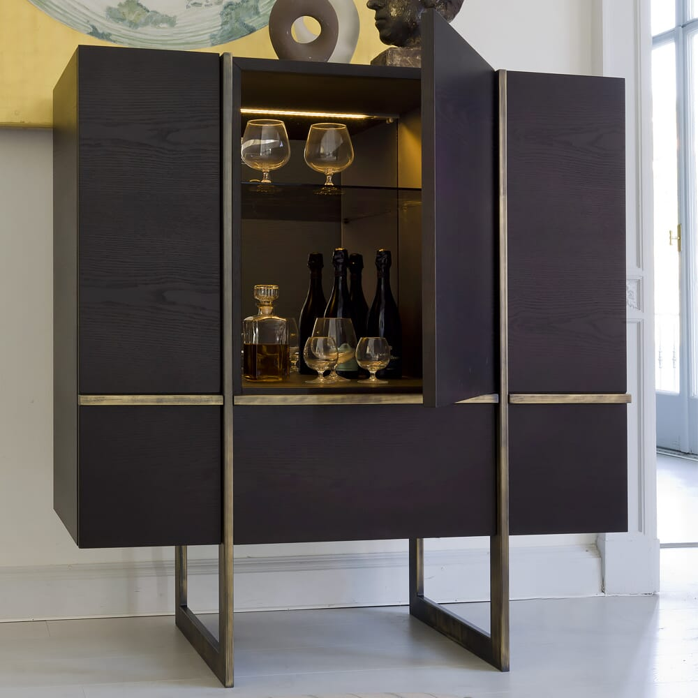 interior design trends, contemporary cocktail cabinet in dark wood with brushed brass accents