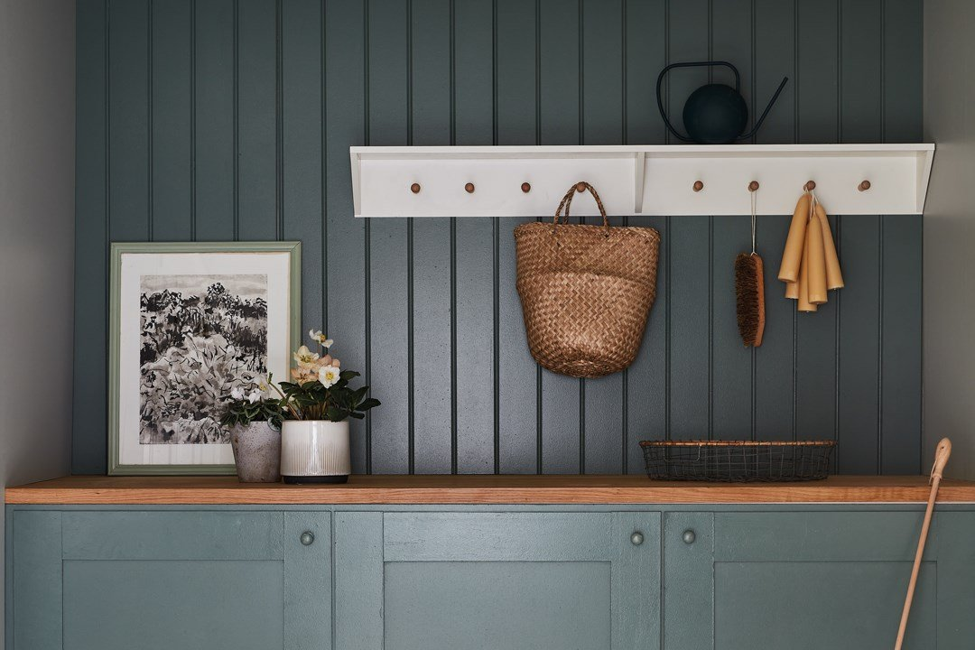 Wood panelled wall and cupboards in Farrow & Ball Green Smoke