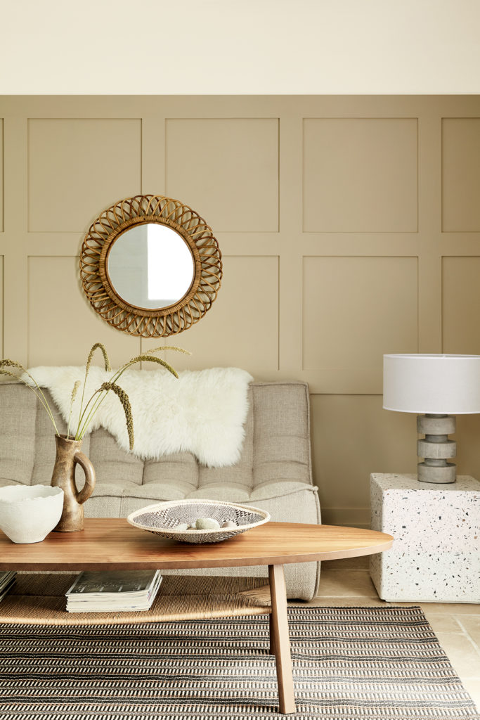 Informal sitting room with a warm neutral scheme, adding texture with sheepskin, wood, stone and rugs