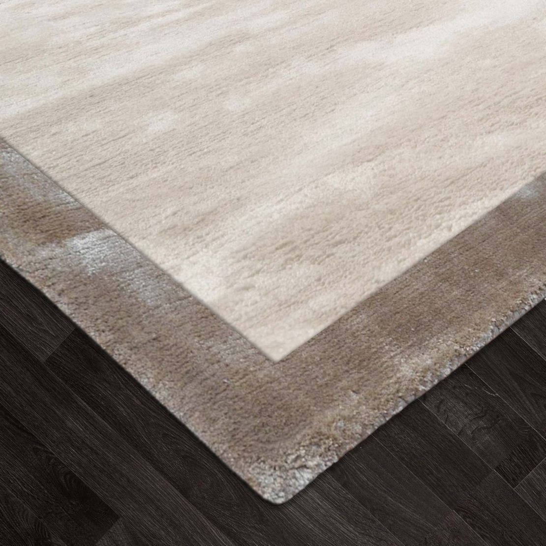 warm neutrals, dark wood floor with a two tone taupe and ivory rug