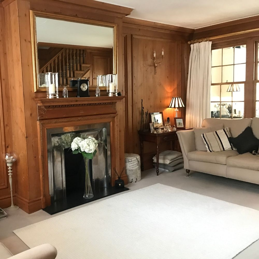 Interior design before, showing dark panelling and fireplace
