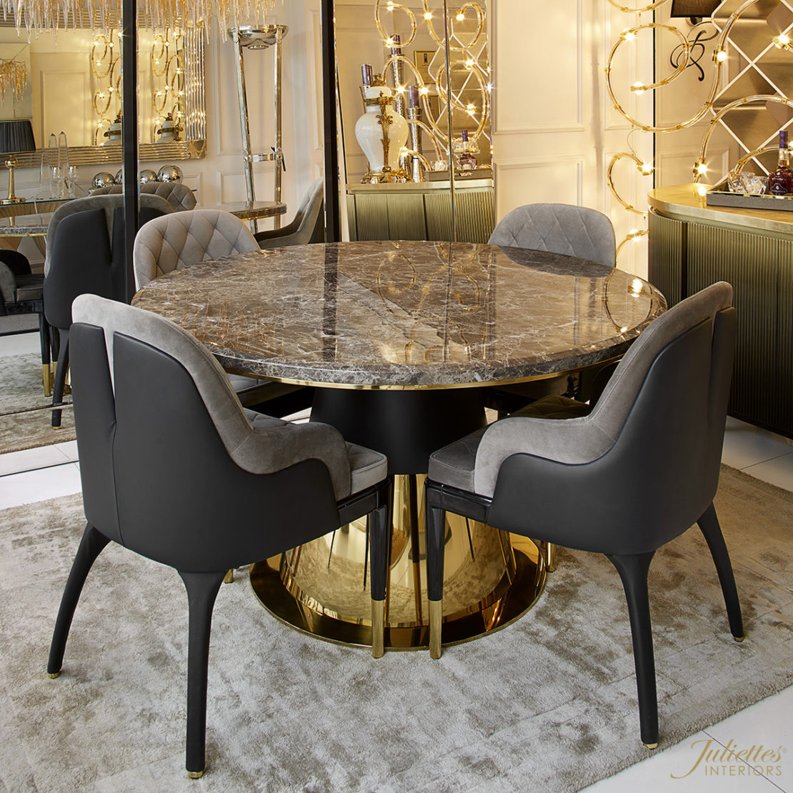 Black and gold small round dining table with dark faux marble top
